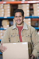 Man in distribution warehouse portrait