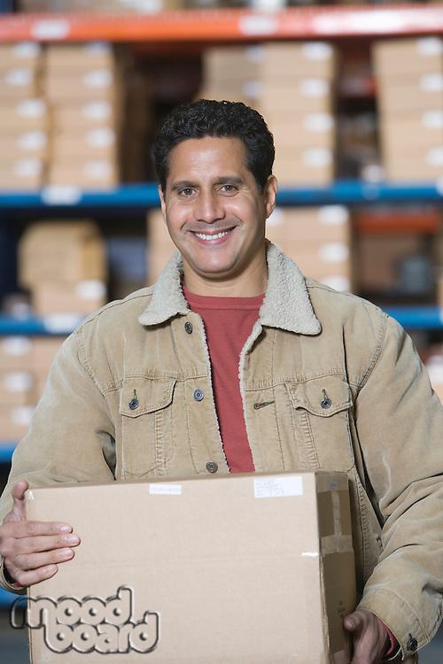 Man in distribution warehouse portrait