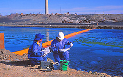 Environmental Engineers Monitoring Ground Water Quality at Industrial Sites