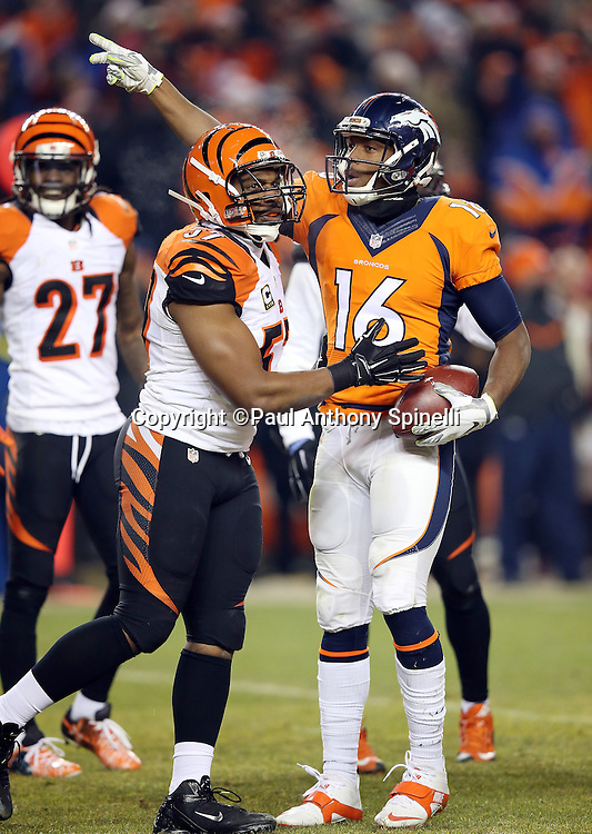 Cincinnati Bengals outside linebacker Vincent Rey (57) takes issue as Denver Broncos wide receiver Bennie Fowler (16) points first down after catching a late fourth quarter pass during the 2015 NFL week 16 regular season football game against the Cincinnati Bengals on Monday, Dec. 28, 2015 in Denver. The Broncos won the game in overtime 20-17. (©Paul Anthony Spinelli)