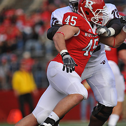 Oct 10, 2009; Piscataway, NJ, USA; Rutgers defensive end Alex Silvestro (45) battles Texas Southern offensive lineman Charles Smith during first half NCAA college football action between Rutgers and Texas Southern at Rutgers Stadium.