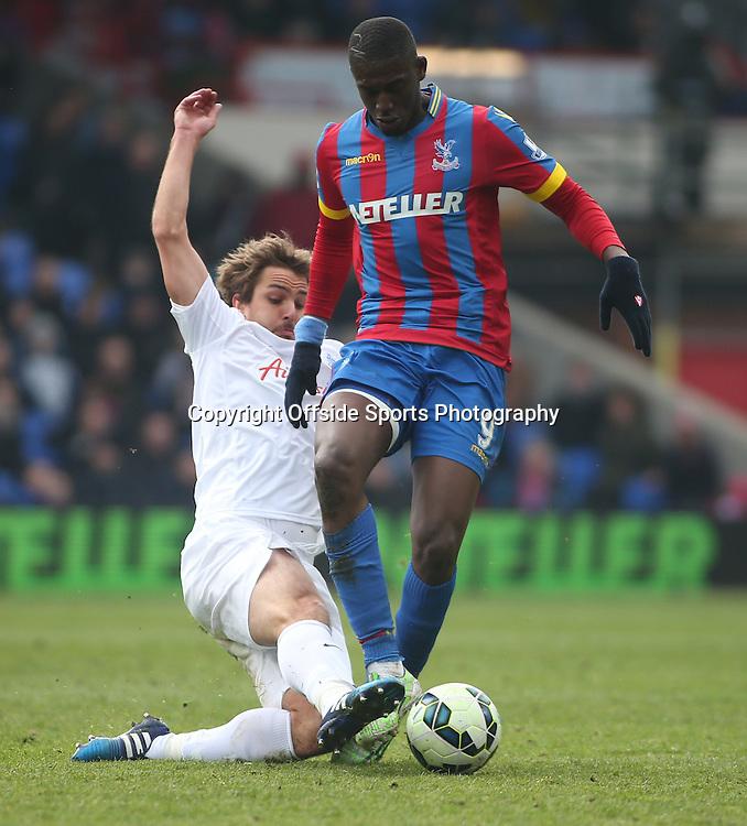 14 March 2015 - Barclays Premier League - Crystal Palace v Queens Park Rangers - Niko Kranjcar of QPR tackles Yaya Sanogo of Palace.<br /> <br /> Photo: Ryan Smyth/Offside