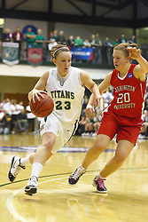 18 March 2011: Olivia Lett moves past the 3 point arch with Kristin Anda guarding during an NCAA Womens basketball game between the Washington University Bears and the Illinois Wesleyan Titans at Shirk Center in Bloomington Illinois.