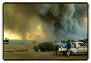 Helicopters drop water bombs as the fire approaches the town of Anakie near Geelong, Victoria, Australia.