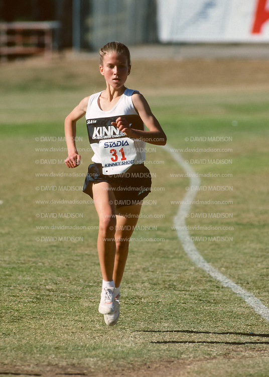 SAN DIEGO - DECEMBER 8:  Melody Fairchild #31 of the United States competes in the 1990 Kinney Cross Country Championships on December 8, 1990 at Balboa Park in San Diego, California.  The meet later became known as the Foot Locker Cross Country Championships.  (Photo by David Madison/Getty Images)
