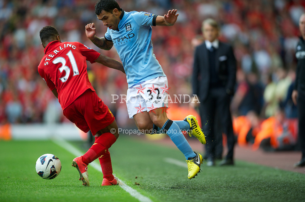 LIVERPOOL, ENGLAND - Sunday, August 26, 2012: Manchester City's Carlos Tevez in action against Liverpool's Raheem Sterling during the Premiership match at Anfield. (Pic by David Rawcliffe/Propaganda)