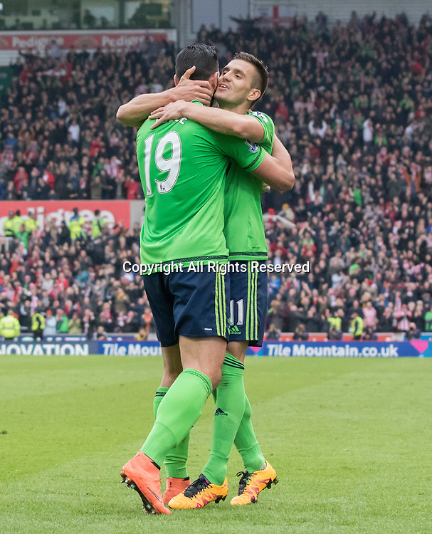 12.03.2016. Britannia Stadium, Stoke, England. Barclays Premier League. Stoke City versus Southampton. Southampton striker Graziano Pelle celebrates with Southampton midfielder Dusan Tadic after he scored his second goal in the 30th minute (0-2).