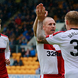 Josh Windass looks on as Captain Kenny Miller Thanks Martyn Waghorn for his pin point delivery