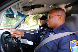 Officer Lofton, in foreground, and Officer Lopez on patrol near Cesar Chavez Park in the Hebbron neighborhood of Salinas.