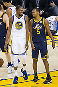 Golden State Warriors forward Kevin Durant (35) smiles at Utah Jazz guard Rodney Hood (5) after being fouled on a lay up at Oracle Arena in Oakland, Calif., on December 27, 2017. (Stan Olszewski/Special to S.F. Examiner)