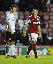 Bristol City's Adam El-Abd shares a joke with Milton Keynes Dons' Samir Carruthers - Photo mandatory by-line: Joe Meredith/JMP - Tel: Mobile: 07966 386802 18/01/2014 - SPORT - FOOTBALL - Ashton Gate - Bristol - Bristol City v MK Dons - Sky Bet League One