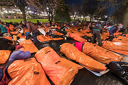 Edinburgh, United Kingdom. 9 December,2017. Sleep in the Park, held in Princes Street Gardens in Edinburgh, will see almost 9000 people sleep outdoors to raise money and awareness of homelessness. Participants bedding down for the night in survival bags in freezing temperatures.