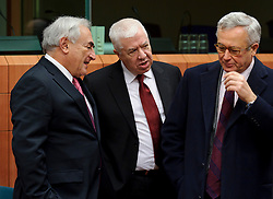 Dominique Strauss-Kahn, managing director of the IMF, left, speaks with Fernando Teixeira Dos Santos, Portugal's finance minister, center, and Giulio Tremonti, Italy's finance minister, right, during a meeting of the Eurogroup finance ministers at the EU Council headquarters in Brussels, Monday, Dec. 6, 2010. (Photo © Jock Fistick)