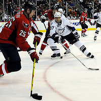 26 December 2007:  Washington Capitals center Viktor Kozlov (25) skates with the puck out of the corner in the first period against Tampa Bay Lightning defenseman Brad Lukowich (37) at the Verizon Center in Washington, D.C.  The Capitals defeated the Lightning 3-2.
