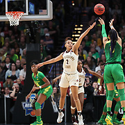 March 31, 2019; Portland, OR, USA; Oregon Ducks forward Satou Sabally (0) makes a three-point shot over Mississippi State Bulldogs guard Andra Espinoza-Hunter (2) in the first half  of  the Elite Eight of the NCAA Women's Tournament at Moda Center.<br /> Photo by Jaime Valdez