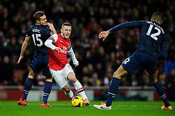 Arsenal Midfielder Jack Wilshere (ENG) beats Man Utd Defender Nemanja Vidic (SRB) - Photo mandatory by-line: Rogan Thomson/JMP - 07966 386802 - 12/02/14 - SPORT - FOOTBALL - Emirates Stadium, London - Arsenal v Manchester United - Barclays Premier League.