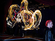Aydika Schwartz twirls colored lights as part of the dance team One Fire during a performance at Dante's Inferno in Portland, Oregon.