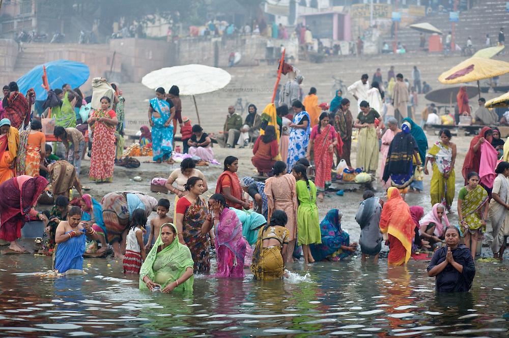 Hindu pilgrims gather at the banks of the Ganges river at the holy city of Varanasi, also known as Benares...Photo: Tom Pietrasik.Varanasi, Uttar Pradesh, India.February 2008