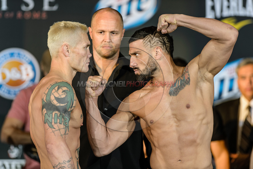 "LONG BEACH, CALIFORNIA, NOVEMBER 1, 2013: Joe Riggs and Mike Bronzoulis face off during the official weigh-in for ""Bellator MMA: Chandler vs. Alvarez II"" inside the Long Beach Convention Center & Arena, California,  (© Martin McNeil)"