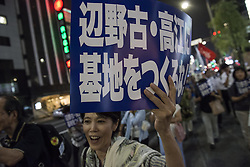 "September 28, 2016 - Tokyo, Tokyo, Japan - Protestor has a sign reads ""Do not build the new military base to Henoko and Takae"" during the demonstration against the construction of a new U.S. military base in Okinawa. The Executive Committee Stop Henoko organized the demonstration as the Abe government continues to put pressure on Okinawa to allow the project to proceed. (Credit Image: © Alessandro Di Ciommo via ZUMA Wire)"