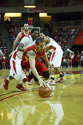 11 December 2010: Shawn King springs for a ball knocked loose by Austin Hill during an NCAA basketball game between the Illinois - Chicago Flames (UIC) and the Illinois State Redbirds (ISU) at Redbird Arena in Normal Illinois.