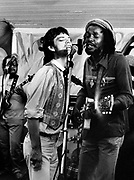 Peter Tosh. Mick Jagger and the Rolling Stones during the Don't Look Back video shoot - Strawberry Hill Jamaica 1978.