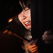 Nai Nai, a 23-year-old live-streamer in Shanghai, China, screams to her camera during a visit to a haunted house.
