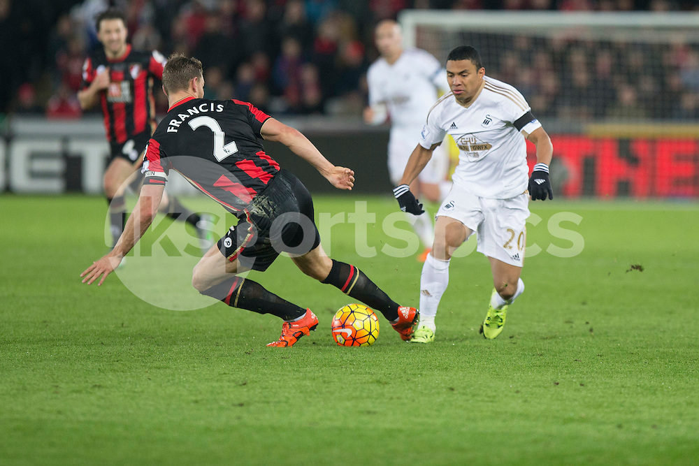 Jefferson Montero of Swansea takes on Simon Francis of Bournemouth during the Barclays Premier League match between Swansea City and Bournemouth at the Liberty Stadium, Swansea, Wales on 21 November 2015. Photo by Mark Hawkins.