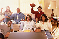 Six friends watching television, cheering