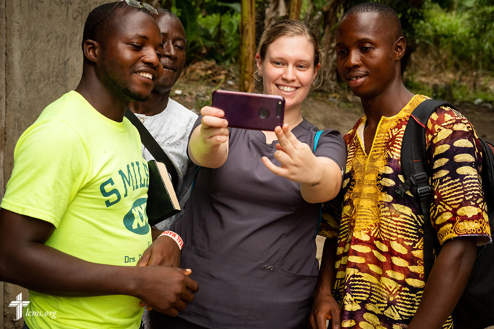 Lauren Awe, a nurse attending Beautiful Savior Lutheran Church, La Vista, Neb., takes a selfie with new Sierra Leonean friends on the fifth day of the LCMS Mercy Medical Team on Friday, May 11, 2018, in the Yardu village outside Koidu, Sierra Leone, West Africa. LCMS Communications/Erik M. Lunsford