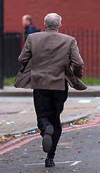 © Licensed to London News Pictures. 11/11/2015. London, UK. Labour Party leader JEREMY CORBYN running to buy a newspaper from a newsagents  in Islington, north London on the day that he is due to be sworn in to Privy Council by Queen Elizabeth II. It is not known if Corbyn, who is a republican, will kneel in front of the Queen,  normally a requirement as part of a swearing-in ceremony for the group that advises monarchs.  Photo credit: Ben Cawthra/LNP