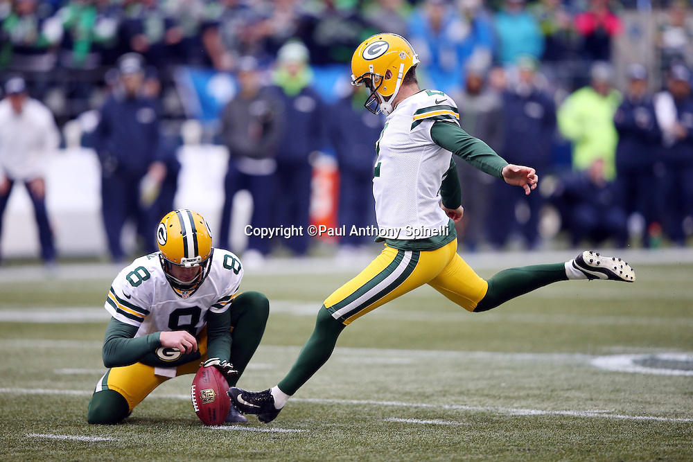 Green Bay Packers punter Tim Masthay (8) holds while Green Bay Packers kicker Mason Crosby (2) kicks a fourth quarter field goal for a 19-7 lead during the NFL week 20 NFC Championship football game against the Seattle Seahawks on Sunday, Jan. 18, 2015 in Seattle. The Seahawks won the game 28-22 in overtime. ©Paul Anthony Spinelli