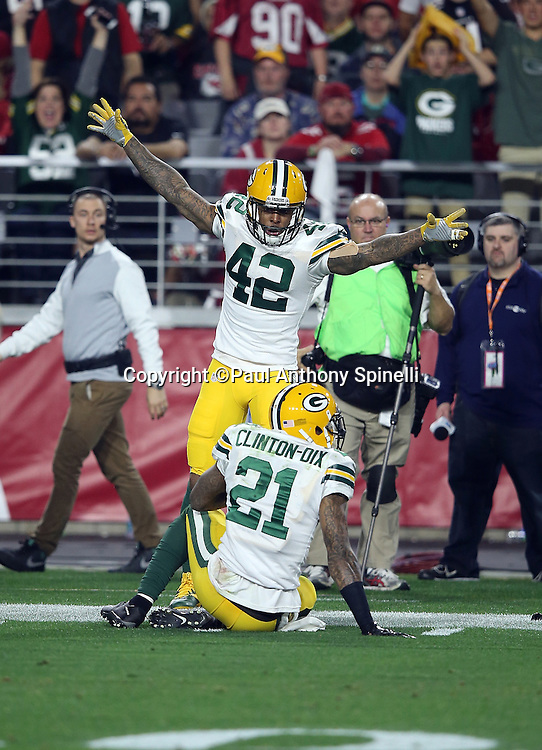 Green Bay Packers strong safety Morgan Burnett (42) waves his arms and celebrates after Green Bay Packers free safety Ha Ha Clinton-Dix (21) intercepts a third quarter pass at the Packers 19 yard line during the NFL NFC Divisional round playoff football game against the Arizona Cardinals on Saturday, Jan. 16, 2016 in Glendale, Ariz. The Cardinals won the game in overtime 26-20. (©Paul Anthony Spinelli)
