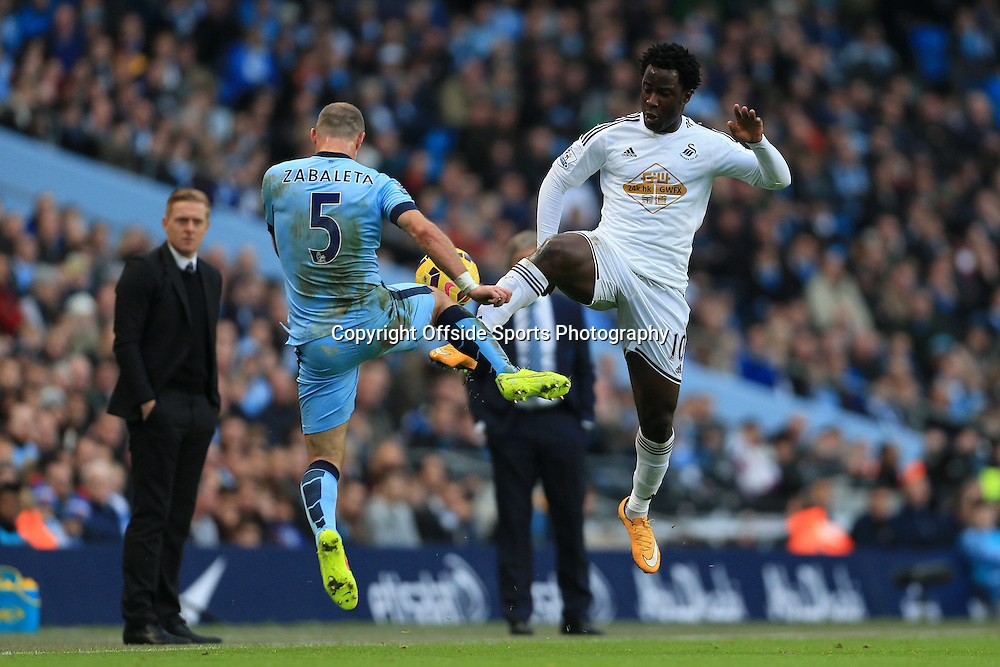 22nd November 2014 - Barclays Premier League - Manchester City v Swansea City - Wilfried Bony of Swansea battles with Pablo Zabaleta of Man City - Photo: Simon Stacpoole / Offside.