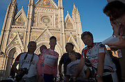 Stage 5 winner, Steven Kruijswijk from Rabobank, poses with race fans in front of Orvieto's Duomo en route to the day's press conference.