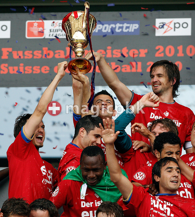 FC Basel goalkeeper Franco Costanzo (top R) holds the trophy while celebrating with his teammates after winning the Super League (National League A) soccer match between BSC Young Boys (YB) and FC Basel (FCB) at the Stade de Suisse stadium in Bern, Switzerland, Sunday, Mai 16, 2010. FC Basel have won the Swiss football championship beating Young Boys of Bern 2-0 in the last match of the season. (Photo by Patrick B. Kraemer / MAGICPBK)