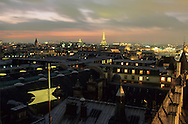 France. Paris. Elevated view on Paris cityscape and the Eiffel tower. paris cityscape , ile de la cite, justice palace,  view from the Conciergerie Bell tower. Before to publish an image of the Eiffel tower lighting you should contact SETE; Mr Dieu at +33144112399 particularly for advertinsing.