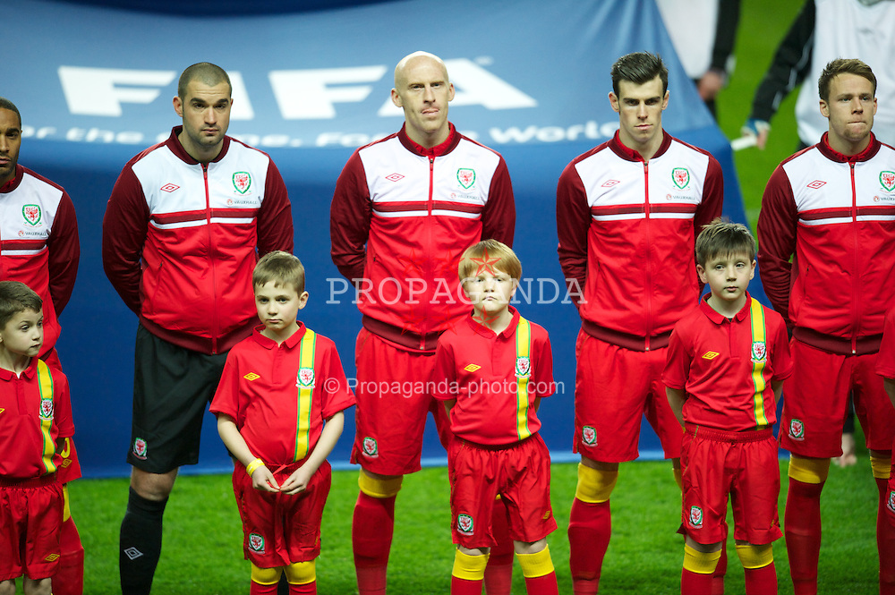 SWANSEA, WALES - Tuesday, March 26, 2013: Wales' goalkeeper Boaz Myhill, James Collins, Gareth Bale line-up before the 2014 FIFA World Cup Brazil Qualifying Group A match against Croatia at the Liberty Stadium. (Pic by Tom Hevezi/Propaganda)