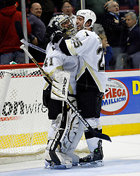 Mar 14, 2007; East Rutherford, NJ, USA;  Pittsburgh Penguins goalie Jocelyn Thibault (41) celebrates with Pittsburgh Penguins center Maxime Talbot (25) after his 3-0 shutout win over the New Jersey Devils  at Continental Airlines Arena in East Rutherford, NJ. Mandatory Credit: Ed Mulholland-US PRESSWIRE Copyright © 2007 Ed Mulholland