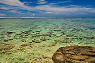 Looking across a calm coral coast lagoon, Fiji