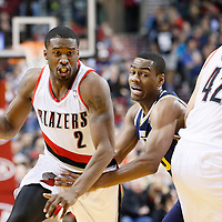 06 December 2013: Portland Trail Blazers shooting guard Wesley Matthews (2) drives past Utah Jazz point guard Alec Burks (10) on screen set by Portland Trail Blazers center Robin Lopez (42) during the Portland Trail Blazers 130-98 victory over the Utah Jazz at the Moda Center, Portland, Oregon, USA.