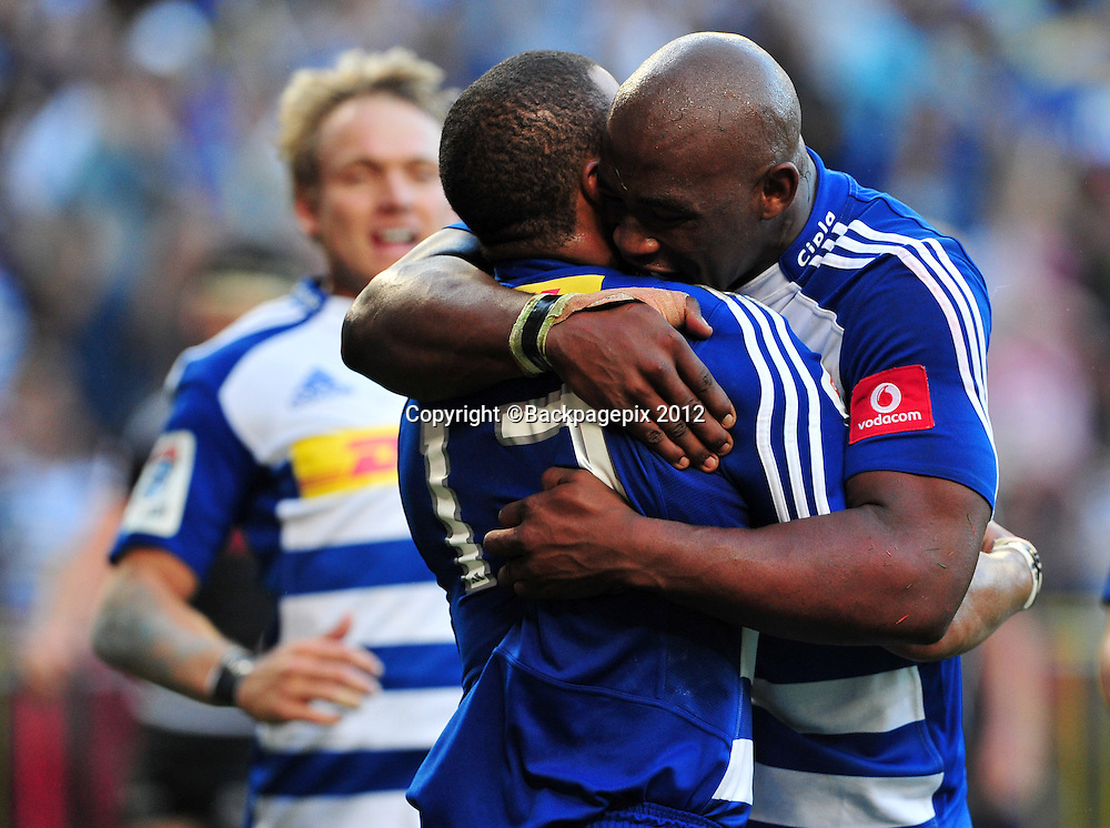 Siya Kolisi of the Stormers celebrates with tryscorer Juan de Jongh during the Stormers 2013 Super Rugby game between the Stormers and the Sharks at Newlands Rugby Stadium on 13 April 2013 ©Ryan Wilkisky/BackpagePix