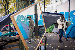 October 31, 2016 - Paris, France - More migrants live in the streets of Paris, France on 31 October 2016. More migrants and refugees coming from the dismantling of Calais and also from Italy are living in the streets of Paris, between the Stalingrad and Jaures tube Stations, in the north of the French capital. The police evacuates one of the camp, with migrants from Afgahnistan and Pakistan. (Credit Image: © Guillaume Pinon/NurPhoto via ZUMA Press)