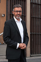 © Licensed to London News Pictures. 28/07/2015, Bristol UK. FAROOQ SIDDIQUE, age 46, arrives at Bristol Magistrates Court charged with three counts of rape, two counts of assault causing actual bodily harm, and one of making a threat to kill. A police spokesman said the charges related to a period between 2009 and 2014. Farooq Siddique is an ex-government adviser, the south west manager for the Government's Prevent strategy, aimed at tackling radicalisation and extremism, and held that position until 2012. He is also a former spokesman and community development officer for the Bristol Muslim Society, is well known within the Muslim community of Bristol, and has spoken out on issues such as terrorism and radicalisation on both a national and city-wide stage.  He was a voluntary Sunday school teacher at Islamic institutions across the city and worked with most of the city's mosques. He was involved with the making of a BBC docu-drama about the radicalisation of Bristol bomber Isa Ibrahim. Photo credit : Simon Chapman/LNP