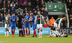 Liam Shephard of of Peterborough United is shown a straight red card after a coming together with Graham Carey of Plymouth Argyle (floored) - Mandatory by-line: Joe Dent/JMP - 07/04/2018 - FOOTBALL - Home Park - Plymouth, England - Plymouth Argyle v Peterborough United - Sky Bet League One