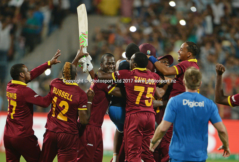 West Indies players celebrates the victory after winning the ICC Twenty20 World Cup final match between England and West Indies at the Eden Garden Stadium in Kolkata, India on April 3, 2016.<br />