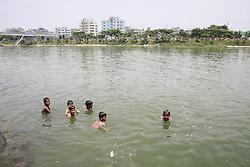 May 5, 2017 - Dhaka, BAngladesh - On the hot summer noon, Bangladeshi children play and take bathe in the polluted water of a lake at Dhaka, Bangladesh, May 5, 2017. Temperature in Dhaka reached 39 degrees Celsius on 5th May. (Credit Image: © Suvra Kanti Das via ZUMA Wire)