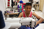 A Bolivian man working in a immigrant sewing workshop in, São Paulo. <br /> <br /> Nearly 90% of the immigrants arriving in São Paulo end up working in the textile industry. <br /> <br /> Today there are about 20,000 sewing shops in São Paulo and 400,000 immigrants working in the clothing sector.