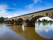 19 JUNE 2016 - DON KHONE, CHAMPASAK, LAOS: An old railroad bridge built by French colonials connects Don Khone Island to Don Det Island. The French built the narrow gauge railroad so they could haul freight through the 4,000 Islands and around the waterfalls in the area. Don Khone Island, one of the larger islands in the 4,000 Islands chain on the Mekong River in southern Laos. The island has become a backpacker hot spot, there are lots of guest houses and small restaurants on the north end of the island.      PHOTO BY JACK KURTZ