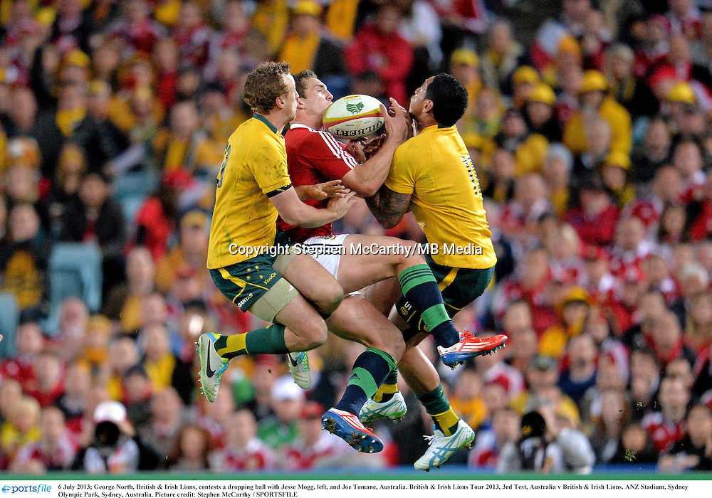 6 July 2013; George North, British & Irish Lions, contests a dropping ball with Jesse Mogg, left, and Joe Tomane, Australia. British & Irish Lions Tour 2013, 3rd Test, Australia v British & Irish Lions. ANZ Stadium, Sydney Olympic Park, Sydney, Australia. Picture credit: Stephen McCarthy / SPORTSFILE